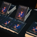 [Image Description: Photograph of copies of Galaxy walk against a black table] via Feruza Afewerki