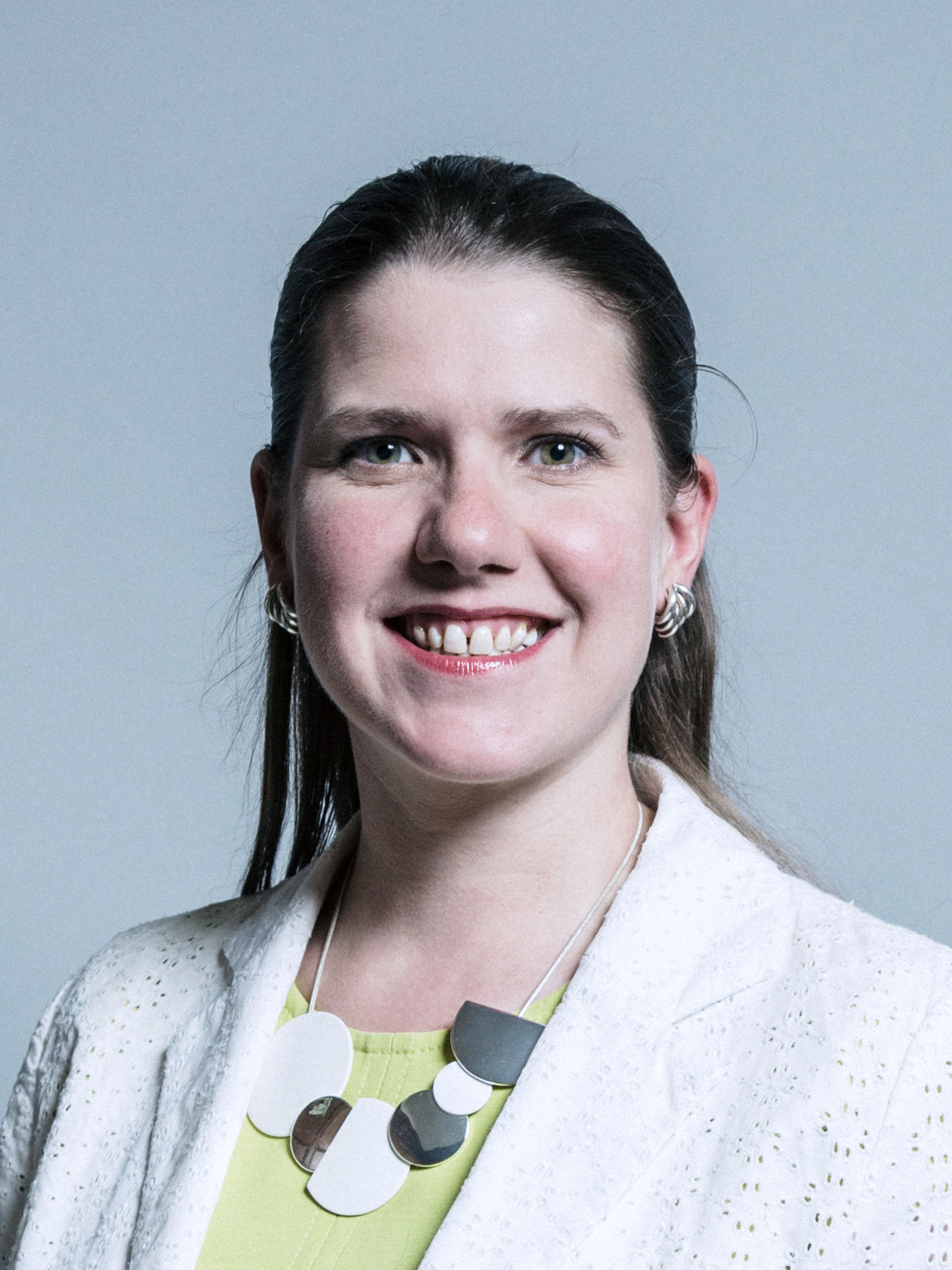 Jo Swinson, a white woman with dark hair, is smiling at the camera
