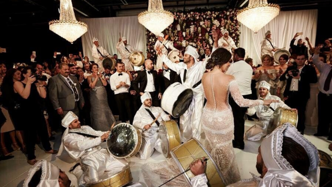 [Image description: A traditional Lebanese wedding tradition showcased during dance.] via Shutterstock
