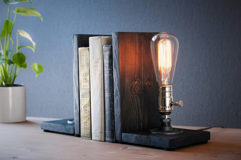 Wooden bookends with Edison-bulbs holding books together.