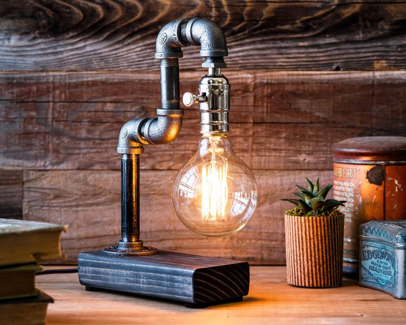Edison-bulb rustic table lamp switched on