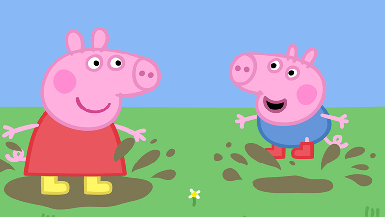 Two pink cartoon pigs jumping in the mud.