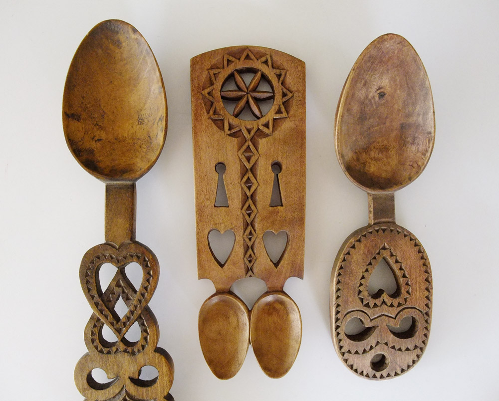 [Image description: A pair of lovespoons for a Welsh  couple] via Shutterstock