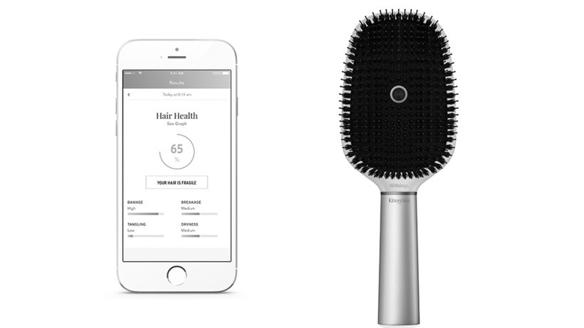 An image of a phone and a hairbrush in the same frame, against a white background.