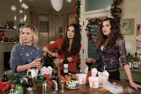Three woman look to the side in concern. They're standing around a table, eating Chinese food and drinking wine.