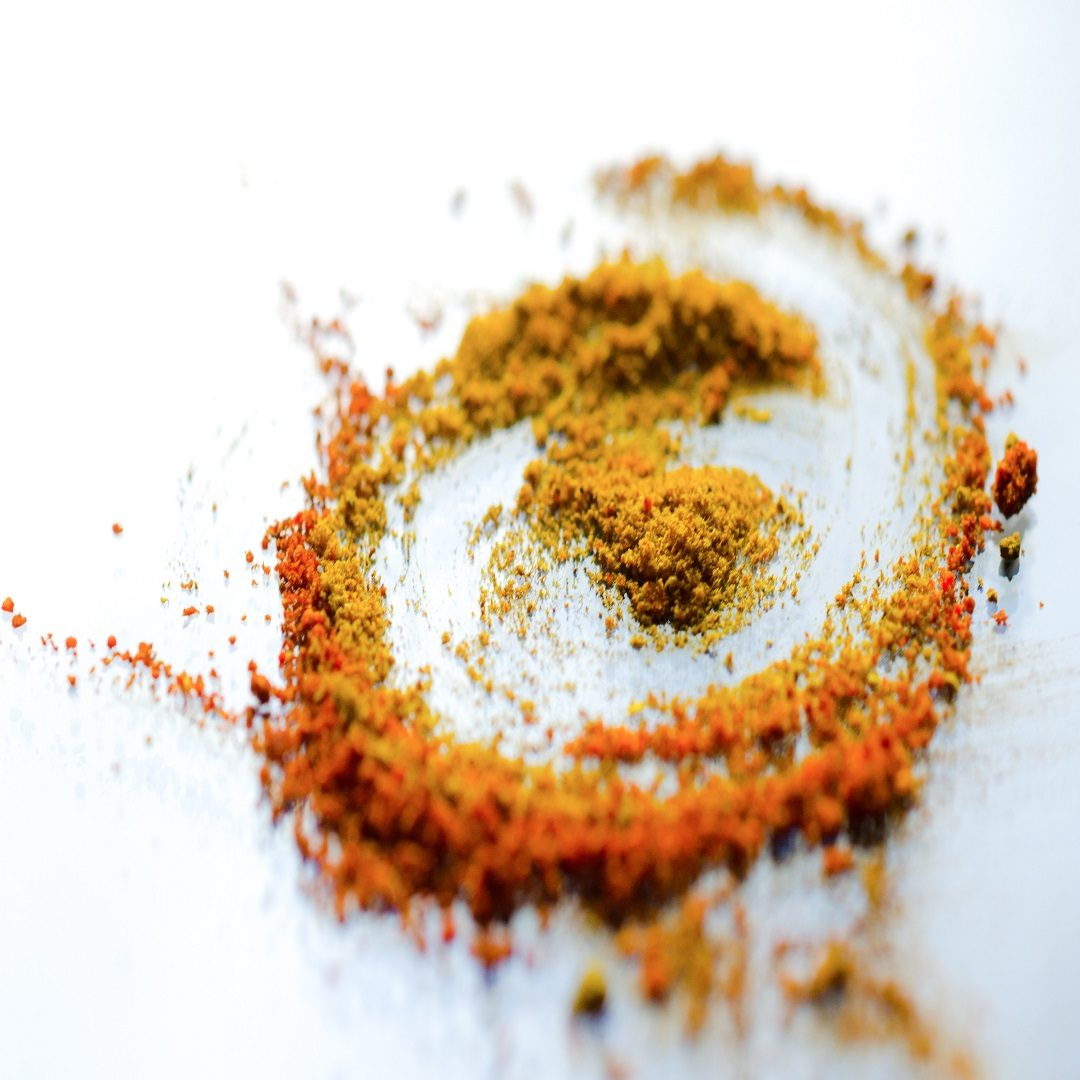 Turmeric and sandalwood powder.