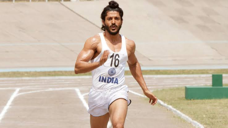 A Sikh athlete is running on the tracks