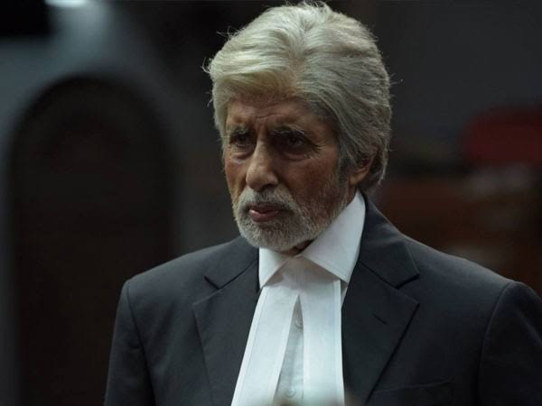 An old white-haired man wearing a lawyers suit.