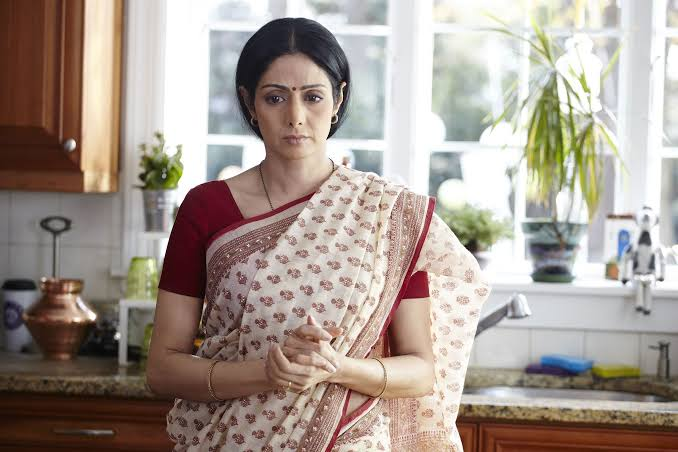 Bollywood Actress Sridevi wearing a traditionale Sari and looking serious in film 'English Vinglish'.