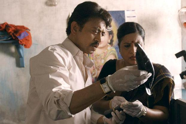 An Indian man and woman inspecting evidence in Bollywood's 'Talvar'.