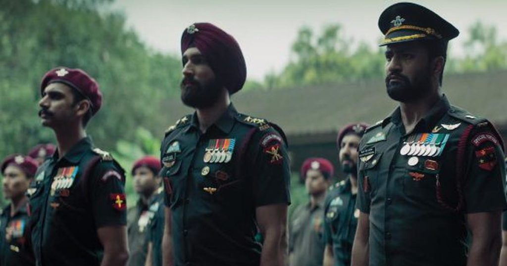 Three Indian army officers standing straight in Bollywood fil 'Uri.