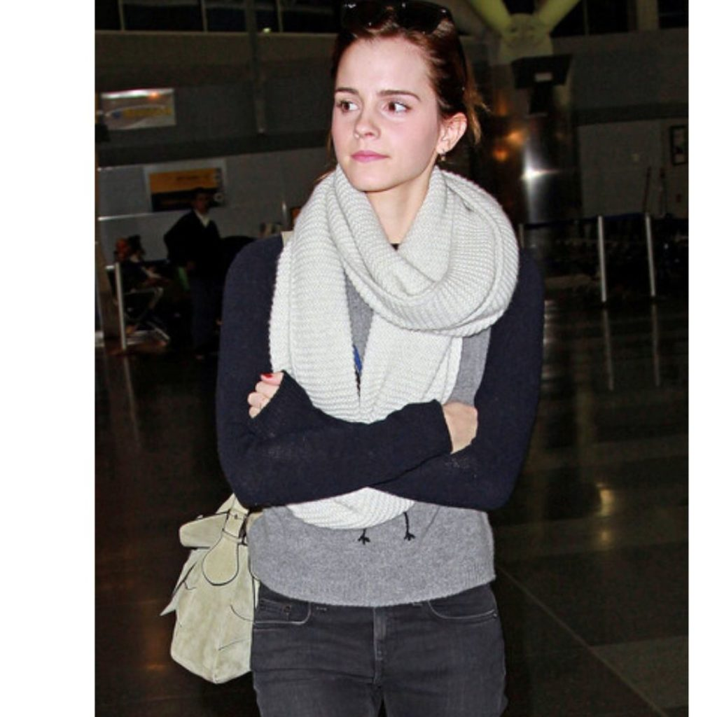 Emma Watson in a simple no-makeup look at an airport.