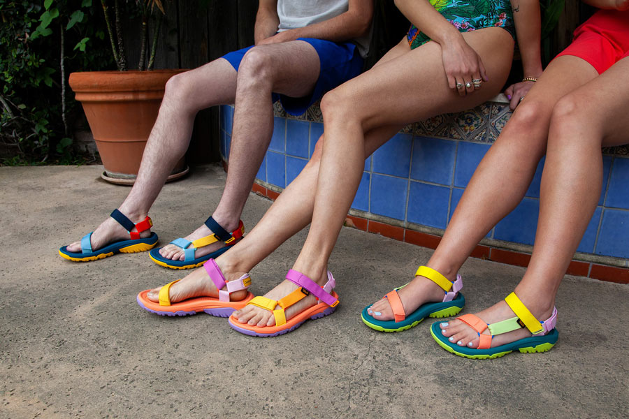 Three models wear sandals from the Teva x Outdoor Voices collection.
