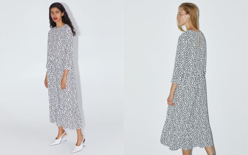 Two women model a long, loose black and white polka-dot dress by Zara.
