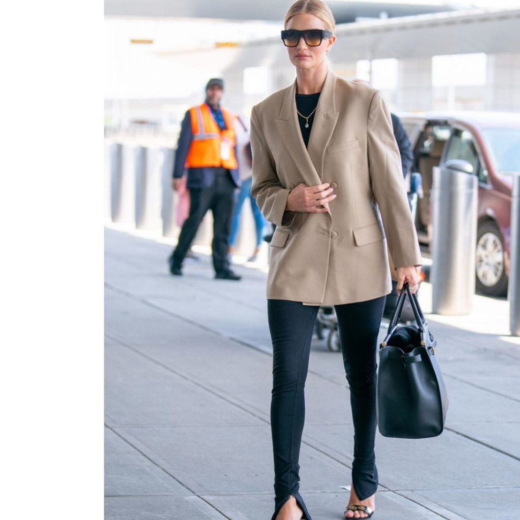 Rosie Huntington-Whiteley wears leggings, a blazer and a big black bag at the airport.