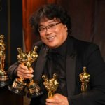 [Image description: Bong Joon Ho holding his Oscars at the 2020 award ceremony] Photo by Richard Shotwell Va Shuttershock.