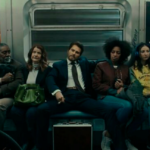 [Image Decsription: A man has his legs spread on a train, while fellow passengers next to him visibly look uncomfortable]