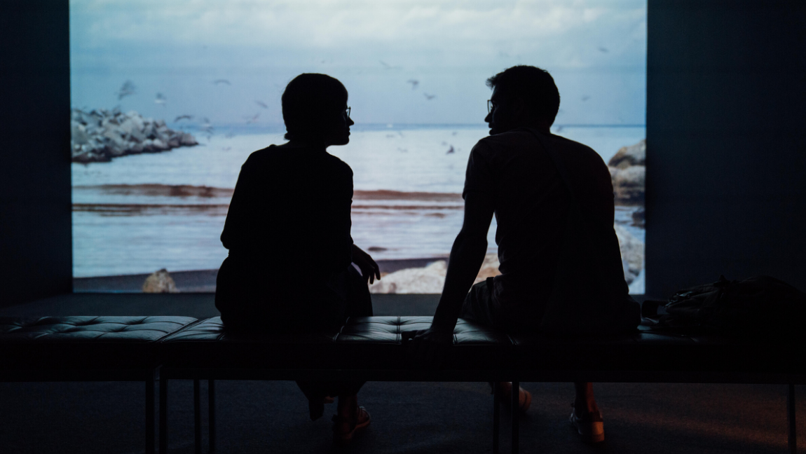 [Image Description: Silhouette of man and woman sat together] Via Unsplash