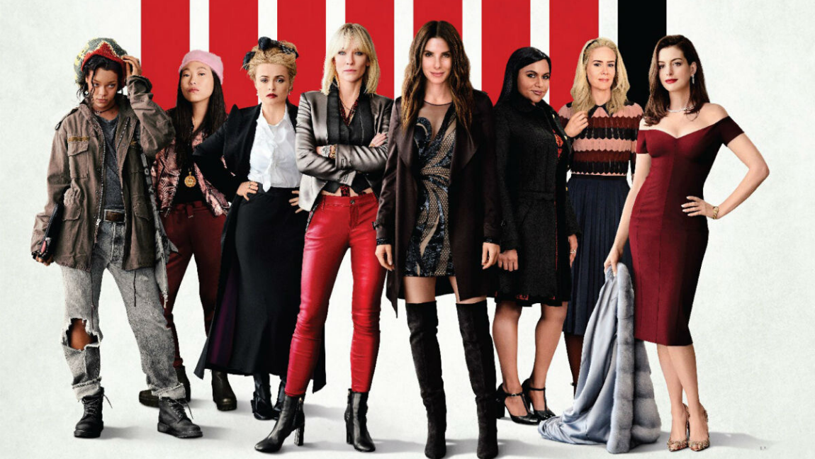 Attribution: [Image description: Still from (Ocean's 8): 8 women stand in various poses facing the camera] via rollingstone.it