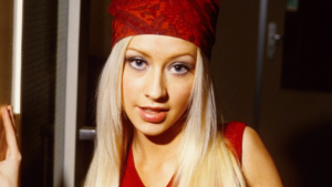 Christina Aguilera wearing a red bandana and a red tank top