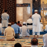 Depiction of group of men praying at the mosque during Ramadan