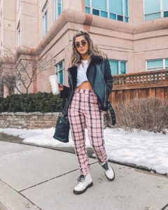 YouTuber Haley wearing Doc Martens and plaid pink pants.