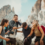 [Image Description: A group of friends- 2 boys, 2 girls- laughing with each other.] via Felix Rostig on Unsplash