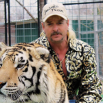 [Image description: Joe Exotic from Tiger King with a tiger.] Via https://lareviewofbooks.org.