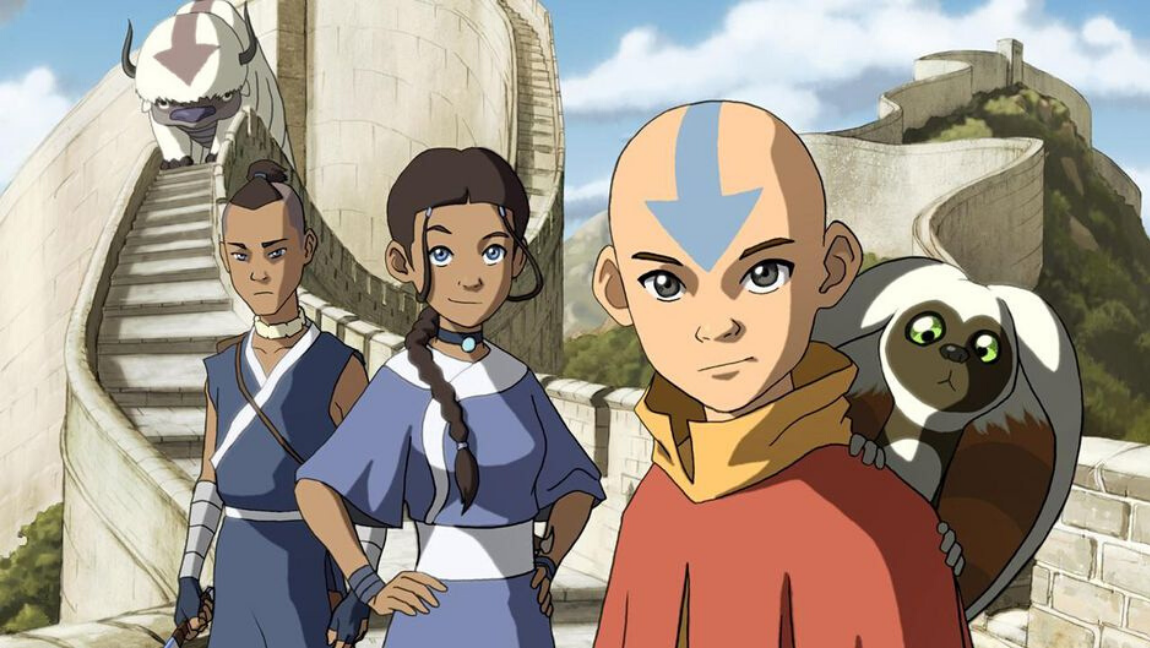 Avatar The Last Airbender main characters standing together with Aang in front