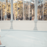 [A girl is standing near the windows at Palacio de Cristal in Madrid] Via Unsplash