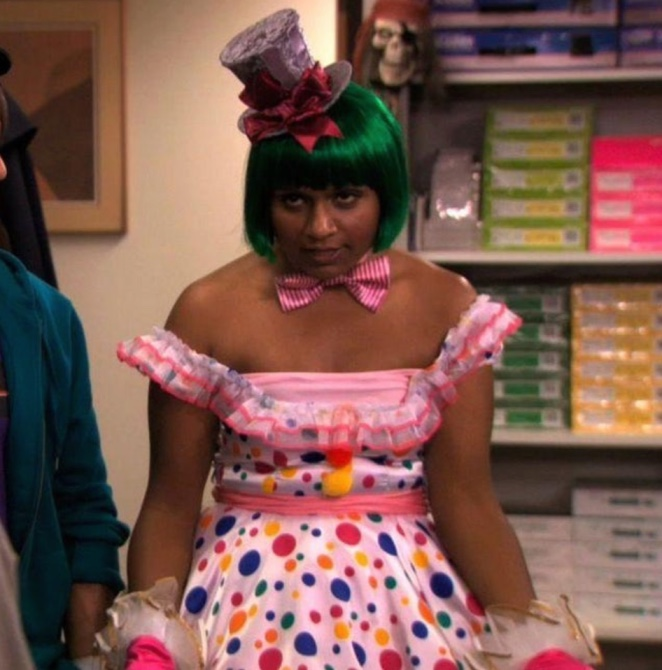 Kelly Kapoor dressed as Katy Perry complete with green wig, mini top hat, and bow tie.