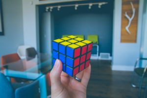 [Image Description: A solved rubric cube held in a hand.] Photo by NeONBRAND on Unsplash