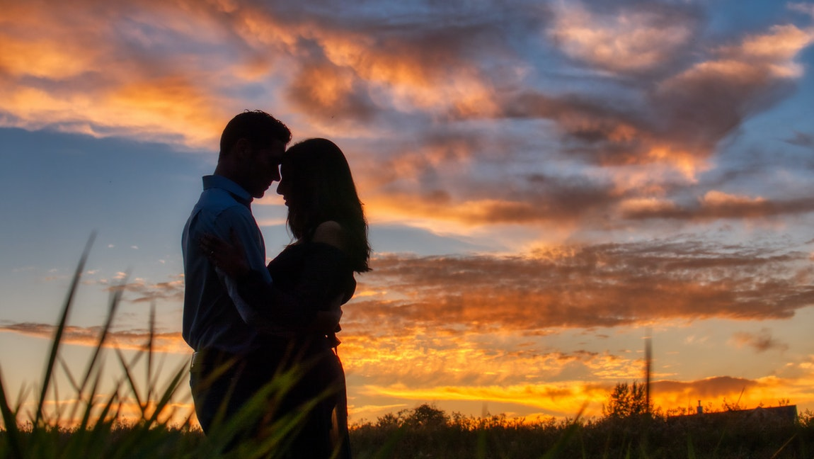 [Image Description: silhouette of a man and a woman holding each other against a sunset.]via Jessica Lewis on Pexels.