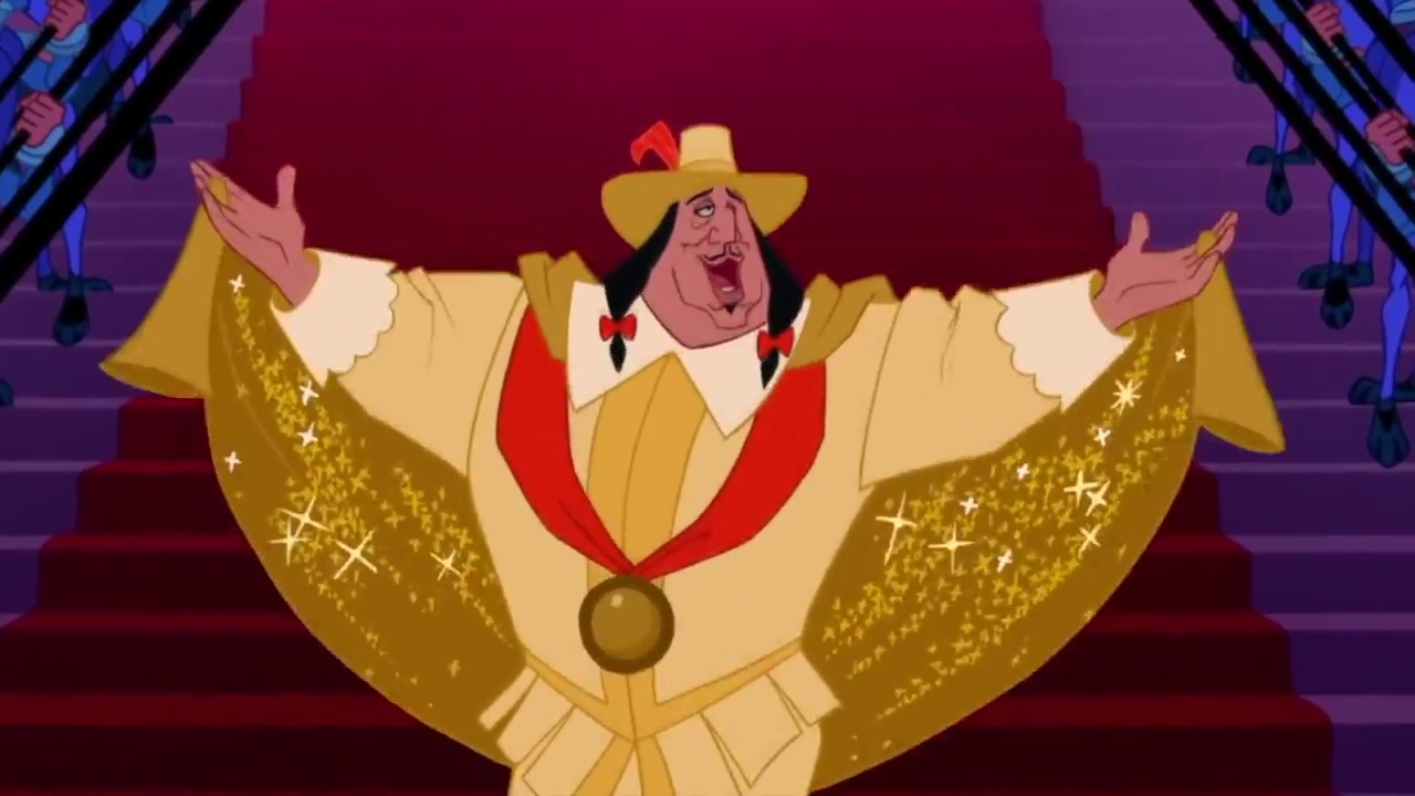 [Image Description: Governor Ratcliffe from Pocahontas singing while dressed fully in gold and holding his hands up in the air.] via Tumblr.
