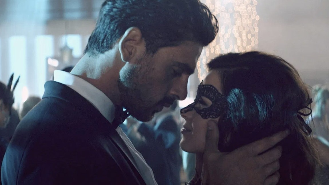 "Actor Michele Marrone, who plays Massimo in the Polish film ""365 Days"" touches the masked face of actress Anna-Maria Sieklucka, who portrays Laura in the film."