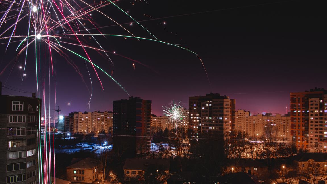 Fireworks captured on a city skyline.