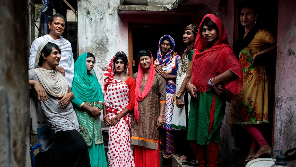 [Image Description: Hijra people posing for a photo in their household in Dhaka, Bangladesh.] Via telegraph.co.uk. Image taken by Jack Taylor.
