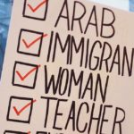 """A protester holds up a sign that reads """"Arab, Immigrant, Woman, Teacher"""". Via Unsplash"""