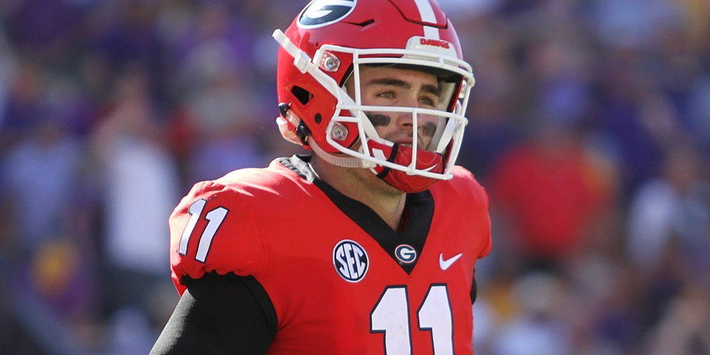 Jake Fromm looks in the distance across the field in his red University of Georgia uniform.