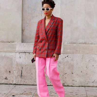 Elizabeth Delphine wearing pink pants with a red plaid blazer