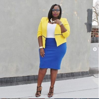 Alissa Wilson wearing a blue pencil skirt with yellow vest