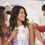 From left to right, Xiomara, Jane, and Alba standing together and smiling.