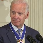 Presidential nominee, Joe Biden, looks to side while wearing his Presidential Medal of Freedom. Via joebiden.com