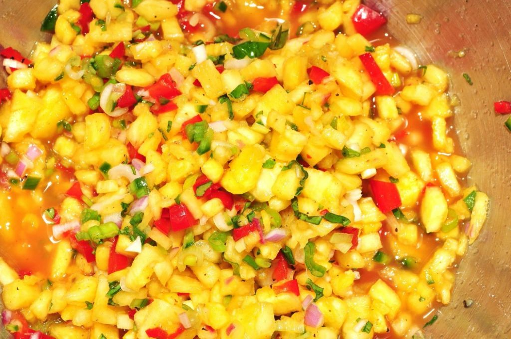 Pineapple salsa with green onions and tomato