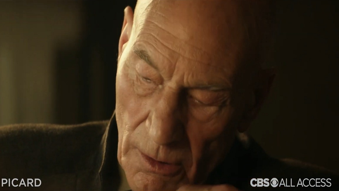 An aged Jean-Luc Picard looked down after decrying the Federation's failure to act that corresponds to his own failure to acknowledge the Federation's colonialism. Star Trek: Picard and Star Trek are property of CBS.