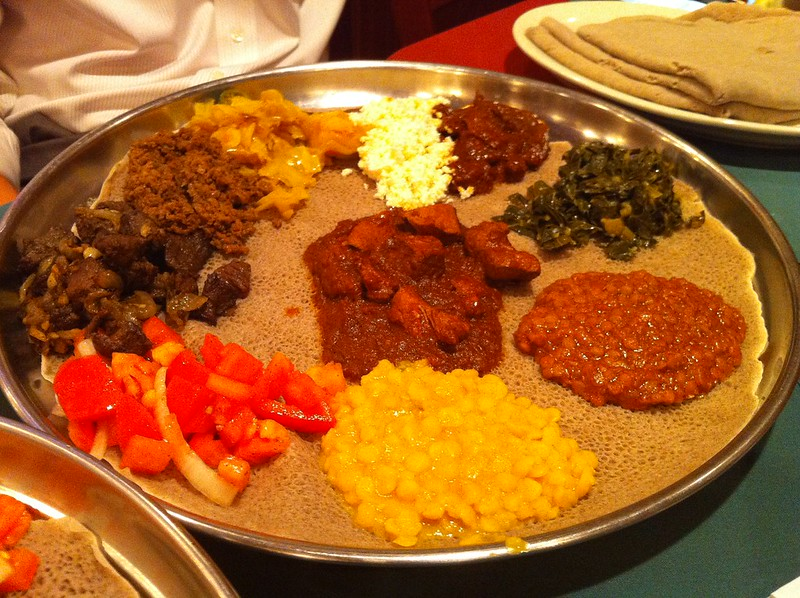 A platter of Ethiopian food served on injera