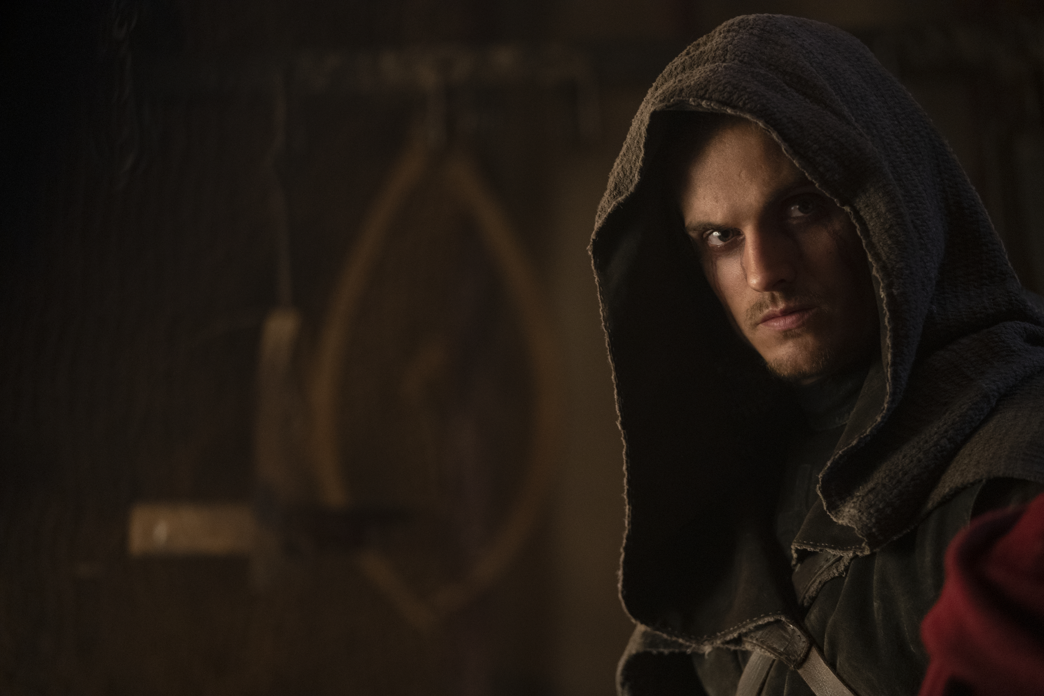 [Image description: The Weeping Monk from Cursed - actor Daniel Sharman wearing a hood and eyes weeping dark tears] Via Netflix
