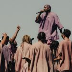 Kanye west performing in a crowd