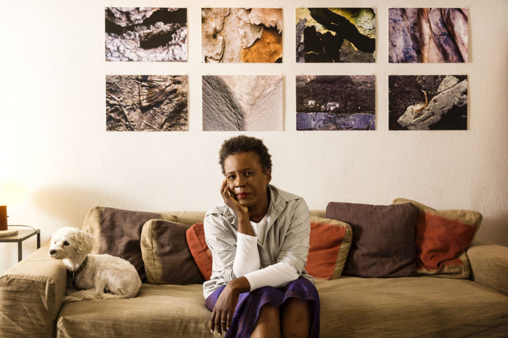 Poet Claudia Rankine and dog Sammy at her home.