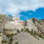 [Image Description: Mount Rushmore, the background is a bright day] Via Unsplash